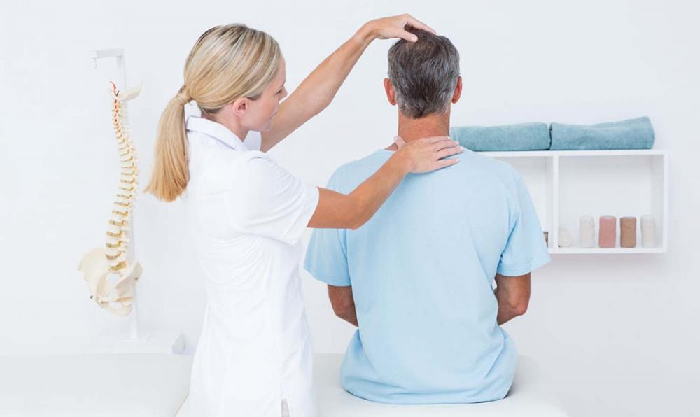 Chiropractor seeking pinched nerve in patient